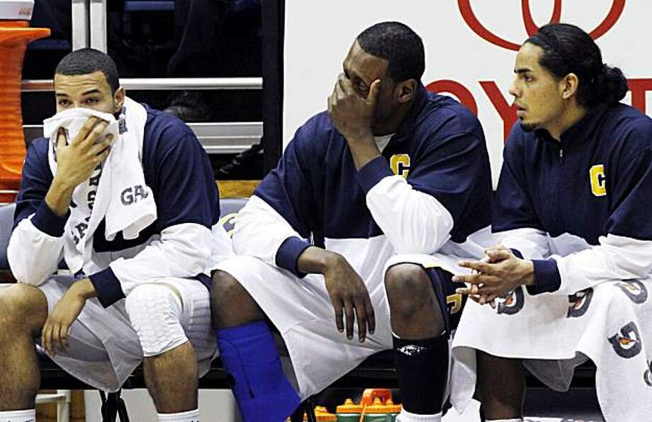California's, from left, Emerson Murray, Markhuri Sanders-Frison and Jorge Gutierrez sit on the bench during the second half of an NCAA college basketball game against Arizona, Saturday, Feb. 5, 2011 in Berkeley, Calif. Arizona beat California 107-105 inovertime. Photo: George Nikitin, AP