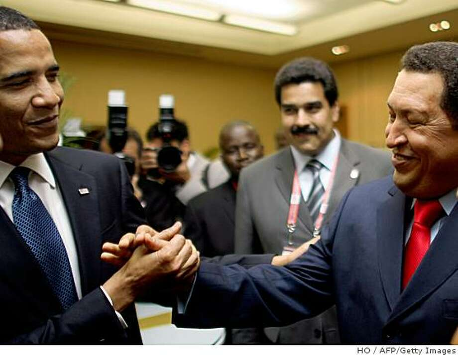 "A handout picture released by the Venezuelan presidency press office showed President Barack Obama and his Venezuelan counterpart Hugo Chavez shaking hands before the opening of the 5th Summit of the Americas in Port of Spain, on April 17, 2009. Obama defended his amicable first encounter with Venezuelan leader and anti-U.S. firebrand Hugo Chavez, which critics back home assailed as naive and ""irresponsible."" ""It's unlikely that as a consequence of me shaking hands or having a polite conversation with Mr. Chavez that we are endangering the strategic interest of the United States,"" Obama told reporters at the close of a Summit of the Americas.  Photo: HO, AFP/Getty Images"