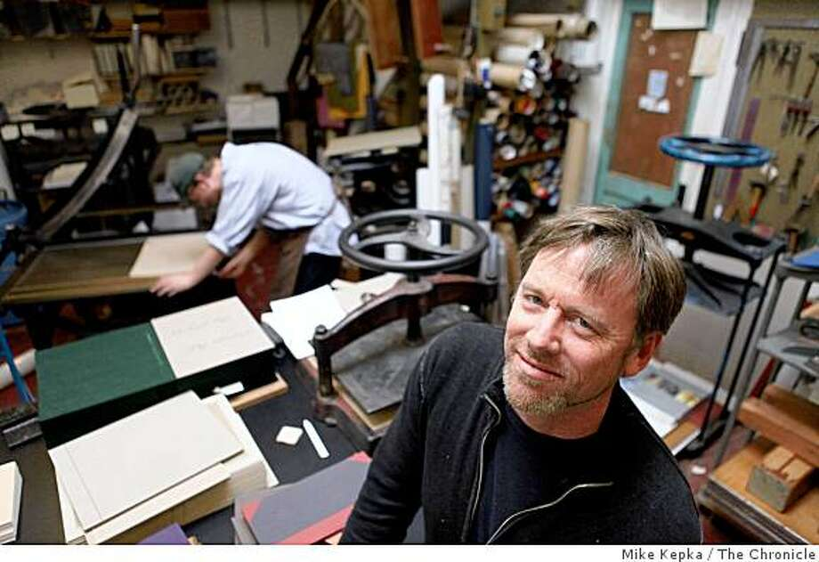 John DeMerritt, a bookbinder, stands for a portrait in his small studio on Monday April 13, 2009. in Emeryville, Calif. He does projects for artists, galleries, fine art publishers, graphic designers, architects, commercial artists and  a couple of huge Silicon Valley firms. Photo: Mike Kepka, The Chronicle