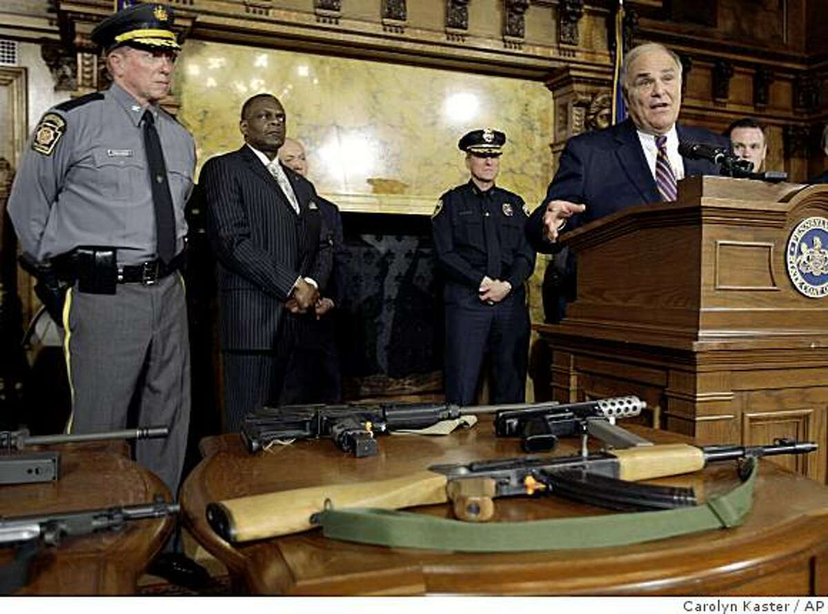 Pennsylvania Gov. Ed Rendell, second from right at podium, address media at a news conference to call for a reinstatement of the federal assault weapons ban at the Capitol in Harrisburg, Pa., Wednesday, April 15, 2009. Standing with Rendell from left, Pennsylvania State Police Commissioner Frank E. Pawlowski, Pittsburgh Police Chief Nate Harper, Jr., York, Pa., Police Commissioner Mark L. Whitman, and at the far right is Pittsburgh Mayor Luke Ravenstahl. On the table in front of the group is a collection of confiscated assault weapons. (AP Photo/Carolyn Kaster)
