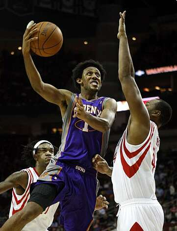 Phoenix Suns' Josh Chldress drives to basket over Houston Rockets' Chuck Hayes in the second quarter during a NBA basketball game on Monday, Nov. 22, 2010, in Houston. Photo: Bob Levey, AP