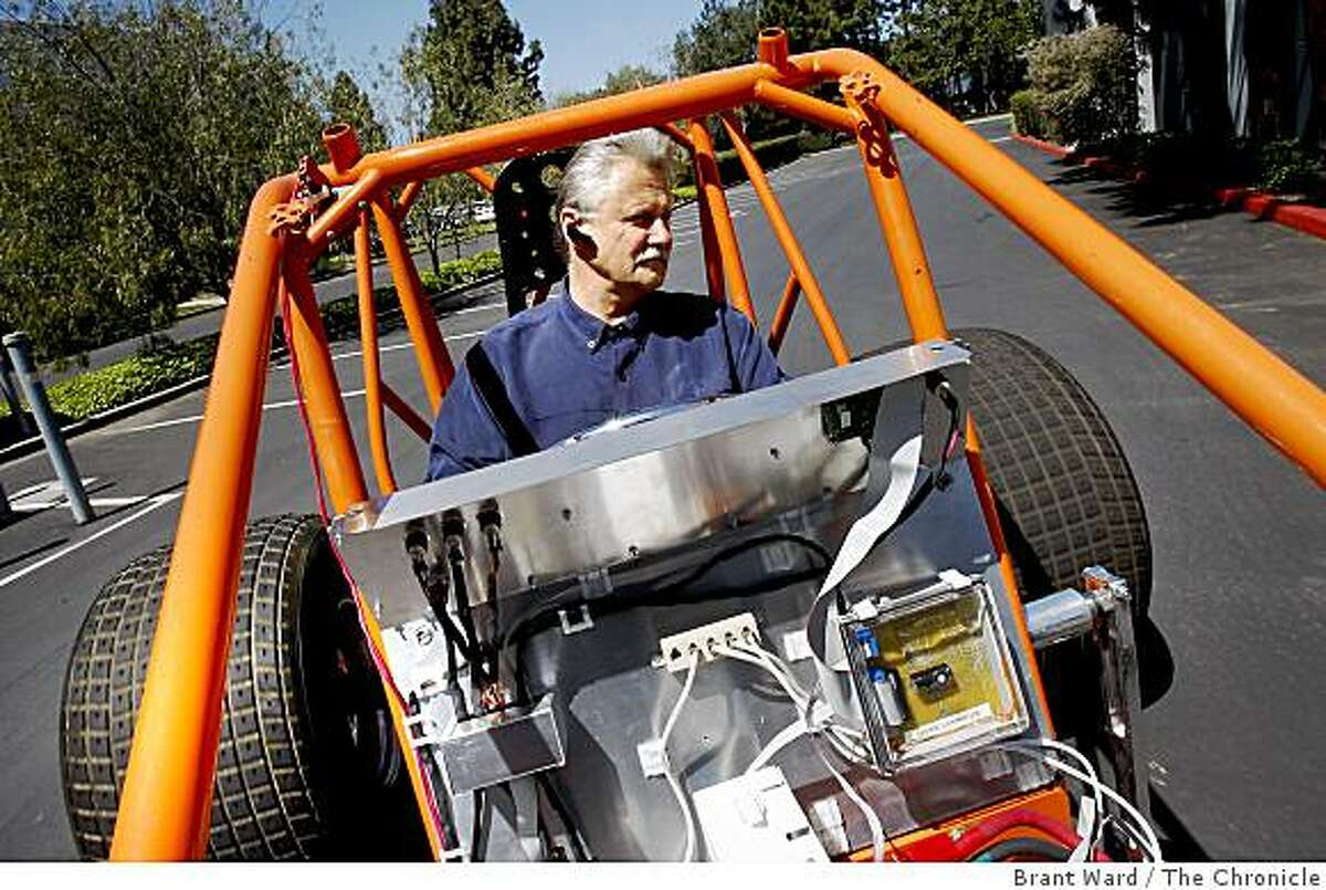 Adura CEO Marvin Bush takes the engineering prototype vehicle for a spin around the parking lot of their Menlo Park laboratory. Adura, a Silicon Valley company, makes powertrains for electric buses. They use multiple battery modules instead of one large battery.