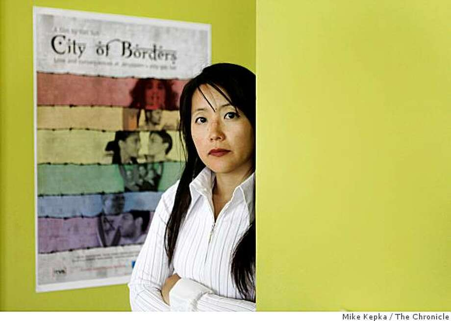 """Documentarian Yun Suh, who made a film called """"City of Borders,"""" about a gay bar in Jerusalem that brings together Israelis and Palestinians, stands for a portrait in her Berkeley home on Tuesday April 7, 2009 in Berkeley, Calif. Suh's film """"City of Borders"""" is screening at the San Francisco International Film Festival later this month. Photo: Mike Kepka, The Chronicle"""