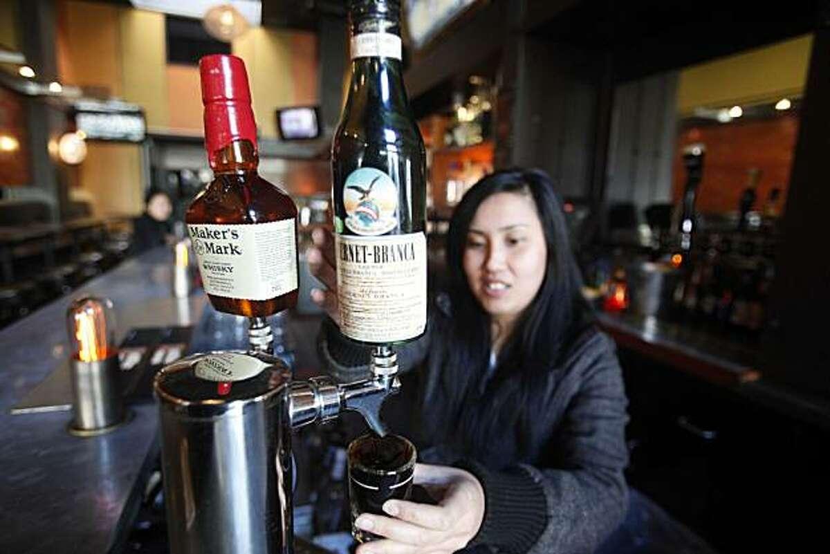 Bullet bar tender, Ivana Tan, pulls a shot of Fernet at the bar on Tuesday Nov, 23, 2010 in San Francisco, Calif.