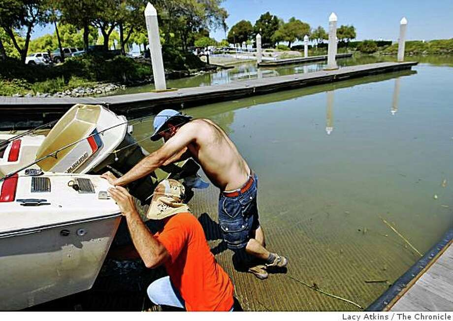 Wilson Toldeo ( left) and Marcello Assis prepare their boat for the Delta waters to fish and relax from the heat,  Monday April 20, 2009, in Pittsburg, Calif. Photo: Lacy Atkins, The Chronicle