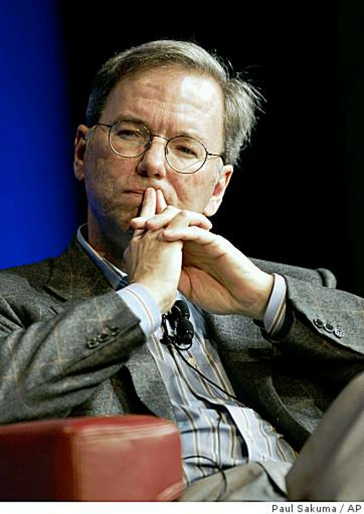 In this Oct. 27, 2008 photo, Google CEO Eric Schmidt ponders a question during a meeting at Google headquarters in Mountain View, Calif. Google Inc. on Thursday, April 16, 2009 announced it eked out a higher profit in the first quarter as the Internet search leader trimmed its work force and winnowed other expenses to overcome the slowest revenue growth since since the company went public nearly five years ago. (AP Photo/Paul Sakuma)