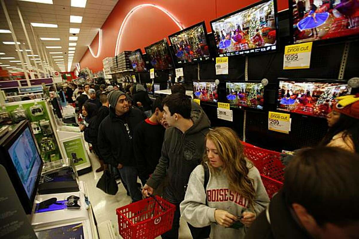 Shoppers rush in at 4:00 a.m. to Target and head to the electronic department in Burbank, California, at the Burbank Empire Center for