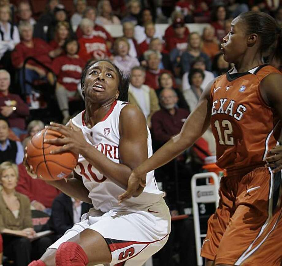 Stanford forward Nnemkadi Ogwumike (30) looks for a shot against Texas guard Yvonne Anderson (12) in the second half of an NCAA college basketball game in Stanford, Calif., Sunday, Nov. 28, 2010. Stanford defeated Texas 93-78. Ogwumike scored 22 points. Photo: Paul Sakuma, AP