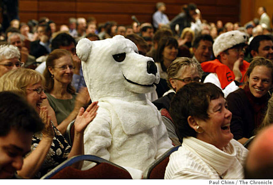 Leah Zimmerman donned a polar bear suit to attend a public hearing convened by the Department of the Interior to address offshore oil drilling in San Francisco, Calif., on Thursday, April 16, 2009. Animal rights activists were hoping Interior Secretary Ken Salazar would address the Endangered Species Act. Photo: Paul Chinn, The Chronicle