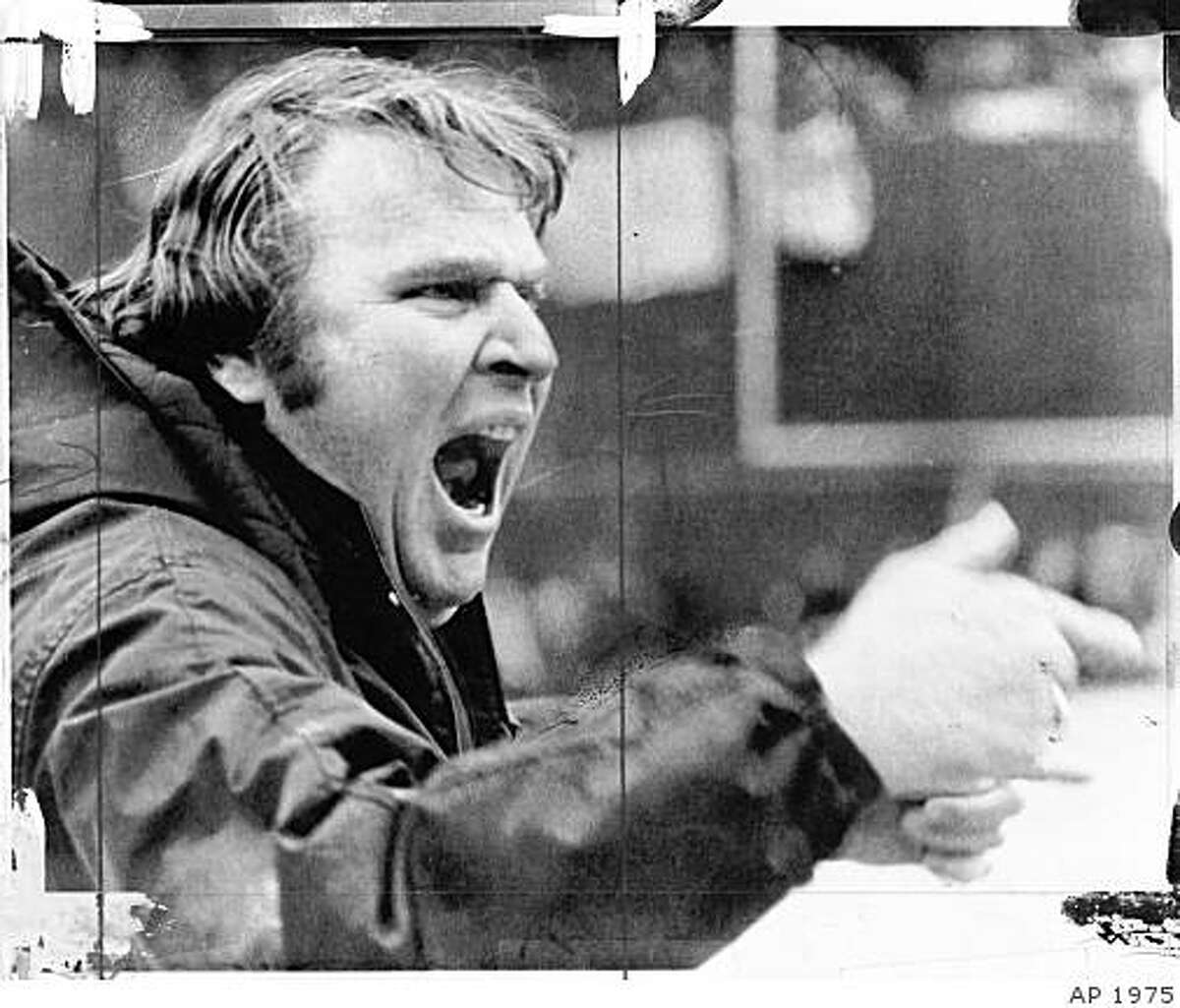 John Madden shouts from sidelines.