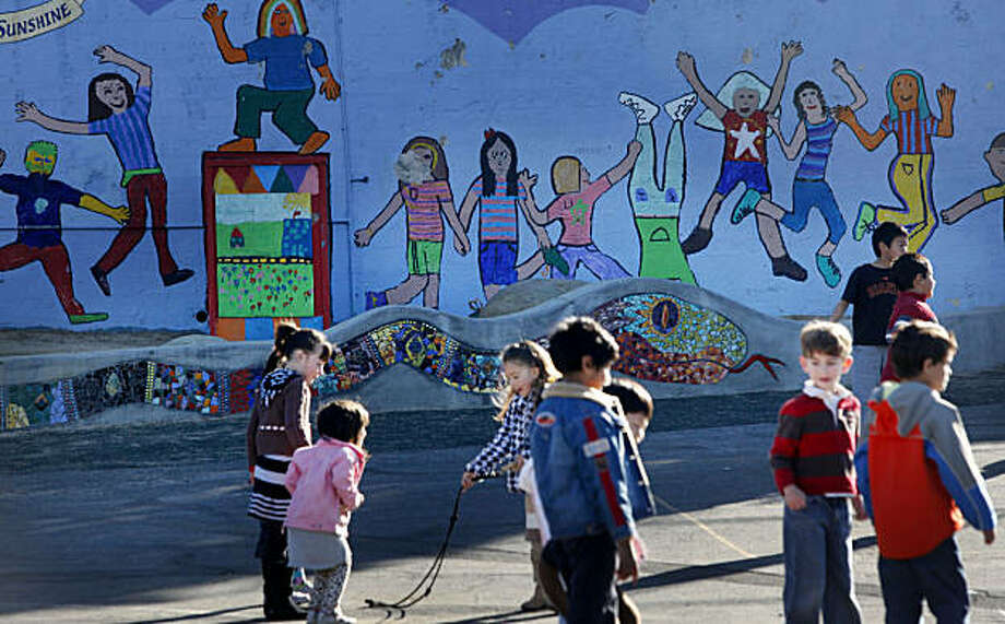 "In front of a mosaic tile called the call ""The Snake Wall,"" Marin Elementary School students play during recess on Wednesday, Nov. 24, 2010 in Albany, Calif. The wall is an art project funded in part by the school's PTA and parent donations. Photo: Mike Kepka, The Chronicle"