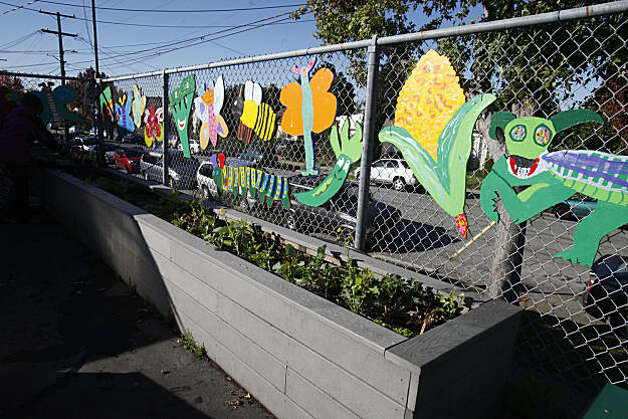 Art hanging in the garden area at Marin Elementary School brightens up the play area on Wednesday, Nov. 24, 2010 in Albany, Calif. The art project is funded in part by the school's PTA and parent donations. Photo: Mike Kepka, The Chronicle