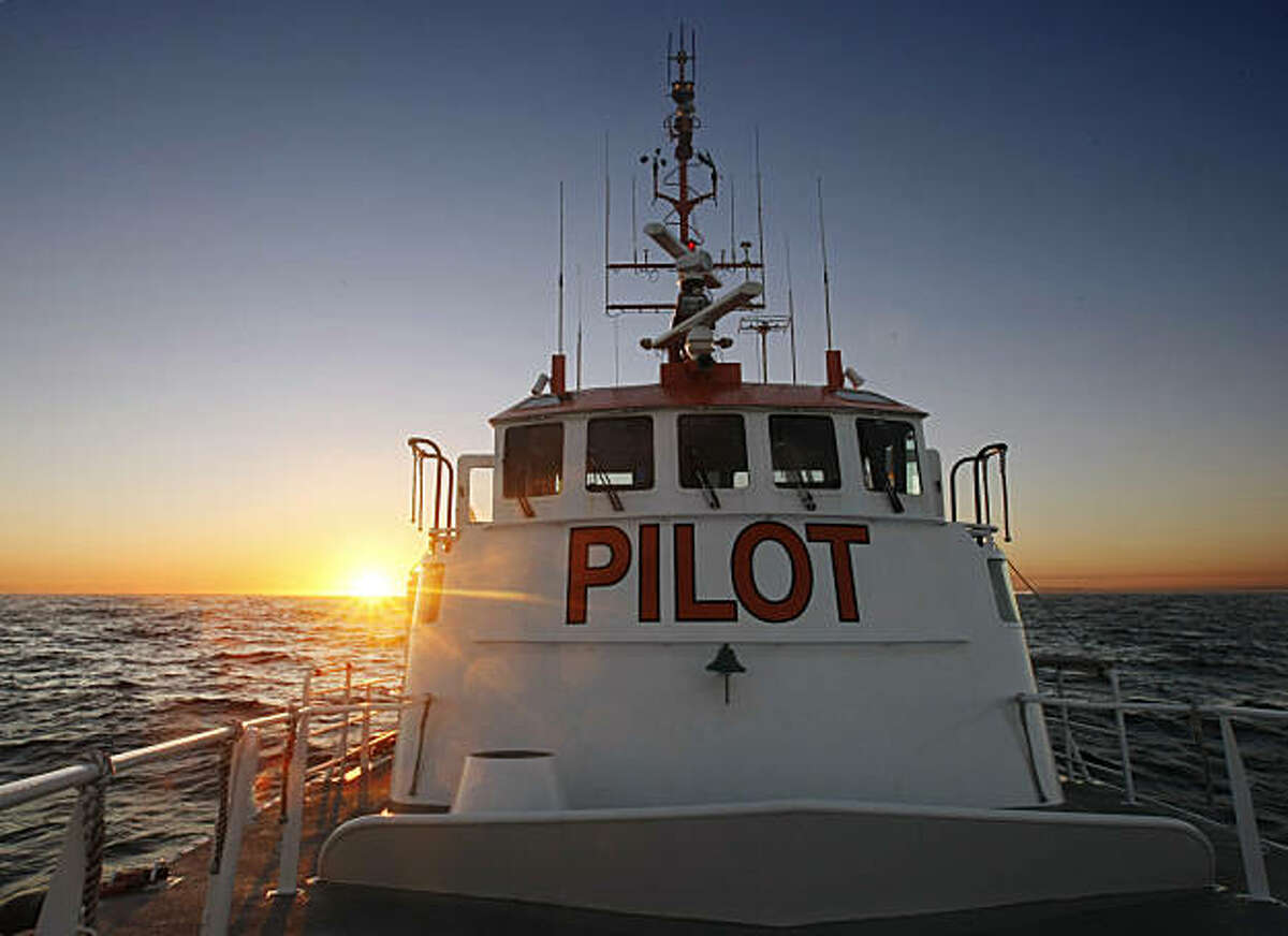 As the sun sets the pilot boat San Francisco waits to transfer pilots to and from the large container ships and cruise liners that need the pilots to dock in the bay in San Francisco. The San Francisco Bar Pilots have been organized since 1850, but pilots have lead ships into the San Francisco Bay going back as far as the 1830s.