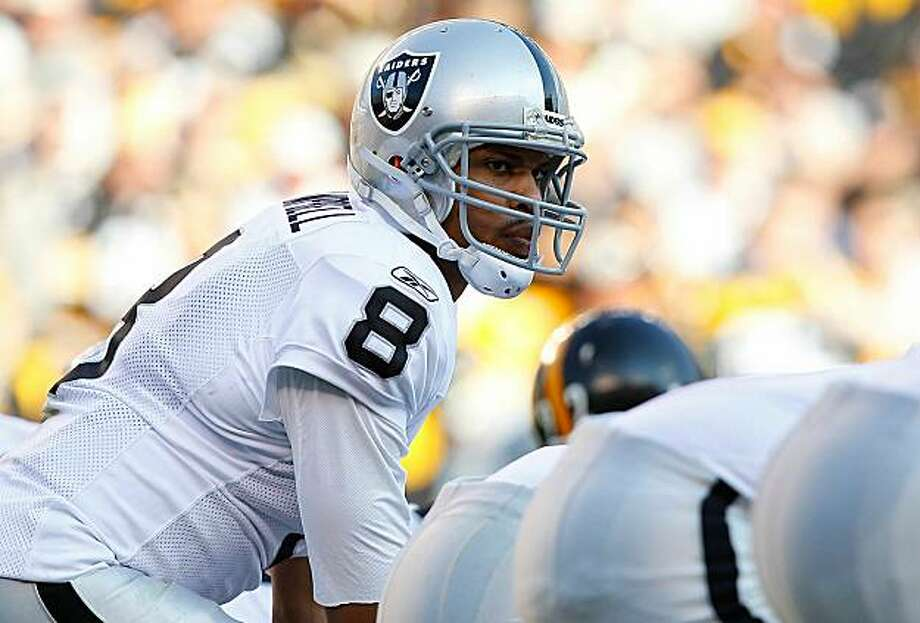 PITTSBURGH - NOVEMBER 21:  Jason Campbell #8 of the Oakland Raiders readies himself behind center during the game against the Pittsburgh Steelers on November 21, 2010 at Heinz Field in Pittsburgh, Pennsylvania. Photo: Jared Wickerham, Getty Images