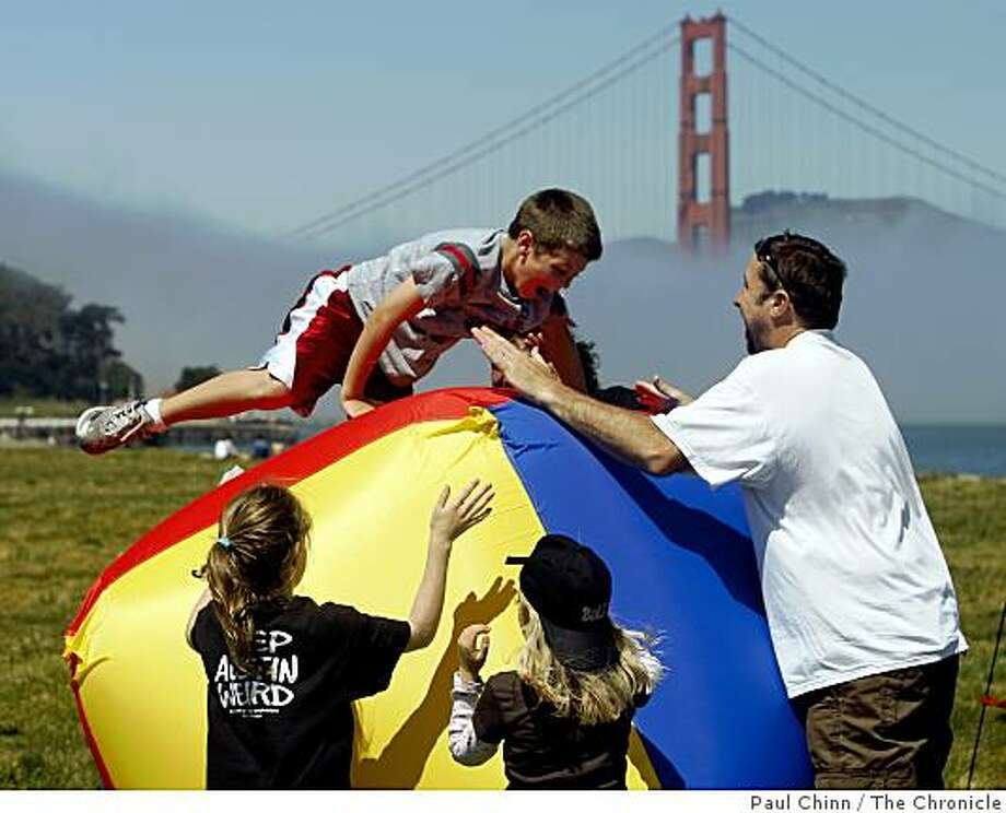 Dylan McAdams, 7, tries to maintain his balance on a bouncing inflatable cube at the Earth Stroll event at Crissy Field in San Francisco, Calif., on Saturday, April 18, 2009. The day-long event was planned as a celebration of Earth Day. Photo: Paul Chinn, The Chronicle