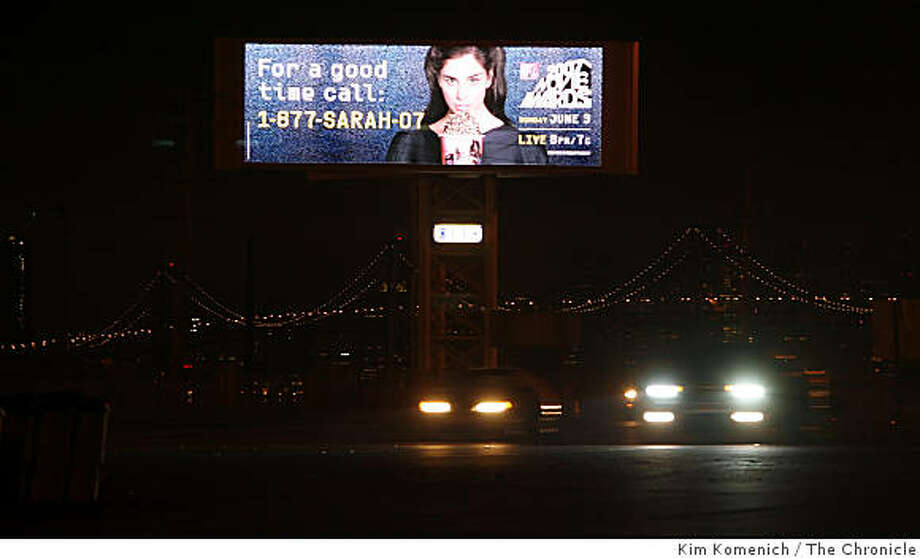 A large billboard near the San Francisco-Oakland Bay Bridge toll plaza generated complaints from drivers until its lights were dimmed. State legislation would allow these signs to proliferate. Photo: Kim Komenich, The Chronicle