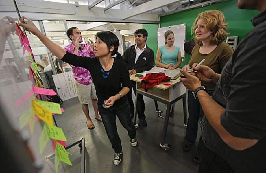 Student, Kimmy Wu attaches post it notes containing thoughts and ideas during  class at the Hasso Plattner Institute for Design at Stanford University, in Palo Alto, Calif., on Friday Nov. 12, 2010. Photo: Michael Macor, The Chronicle