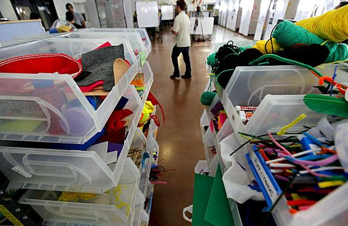 Bins of materials that students use to transform their thoughts and ideas into sit idle while a brainstorming session is underway at the Hasso Plattner Institute for Design at Stanford University, in Palo Alto, Calif., on Friday Nov. 12, 2010.