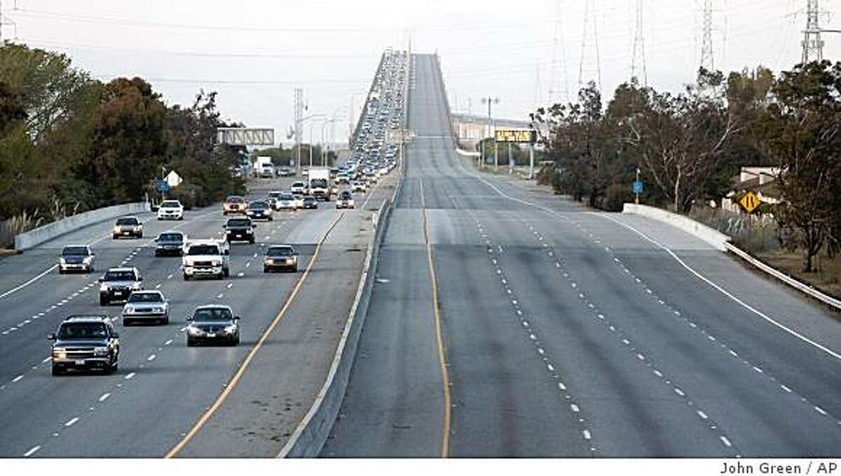 Eastbound lanes of the San Mateo-Hayward Bridge are closed in Foster City, Calif., during peak commute hours on Tuesday, April 14, 2009. Traffic was forced to exit at Foster City Boulevard due to high winds on the bridge. (AP Photo/Contra Costa Times, John Green)