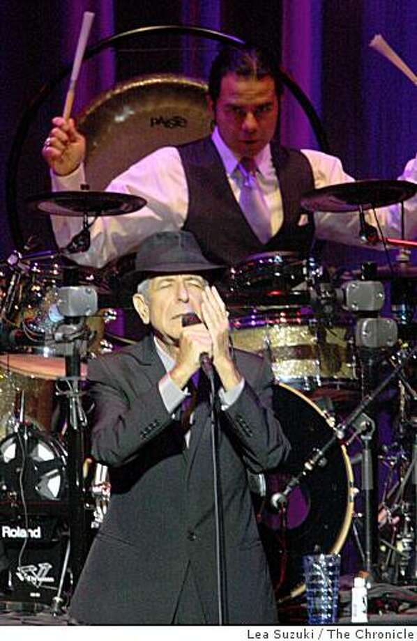 Leonard Cohen (foreground left) performs at the Paramount Theatre in Oakland, Calif. on Monday April 13, 2009. Photo: Lea Suzuki, The Chronicle