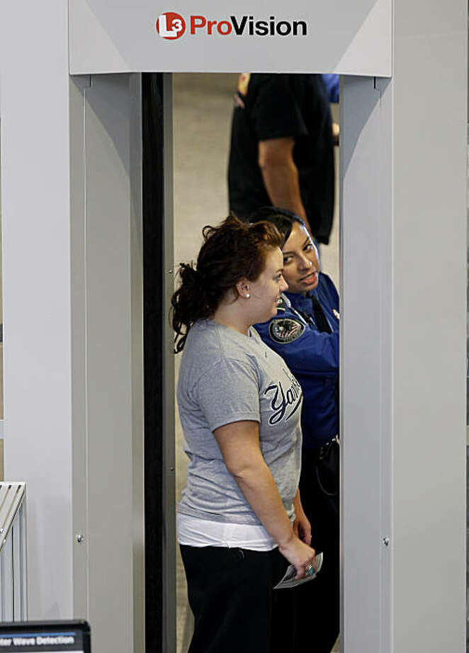 Passengers who chose the full-body scan were instructed on how to stand. Travelers at San Francisco International Airport were subjected to full-body scans and occasional pat-downs Tuesday November 23, 2010. Photo: Brant Ward, The Chronicle