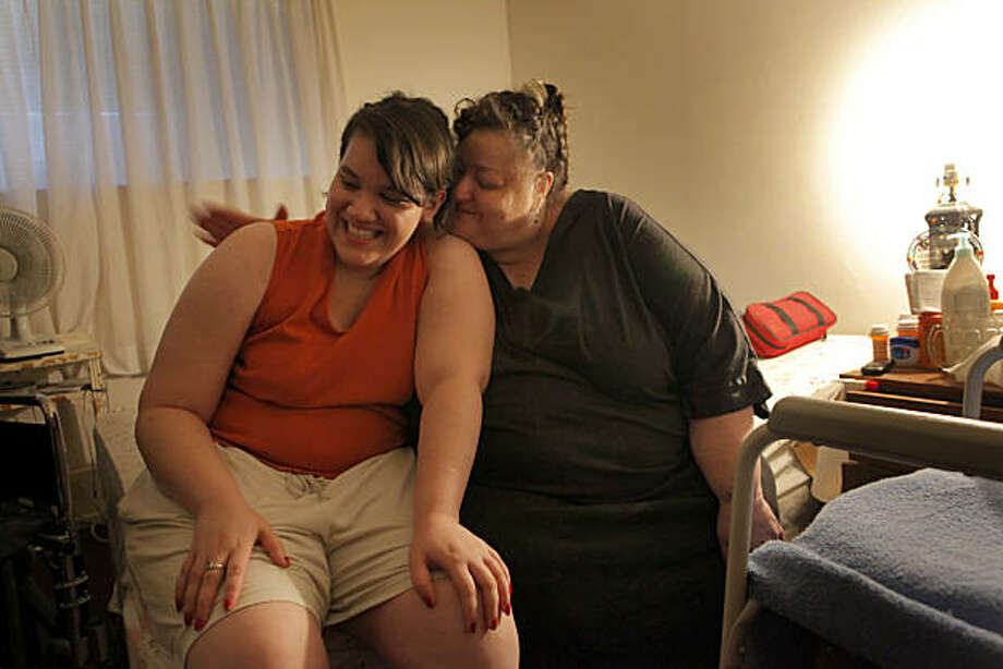 Trina Sanchez gives her daughter Patricia a hug as they sit on Trinas' bed, Thursday Nov. 11, 2010, in Vallejo, Calif. Trina spends most of her day in bed because of her disability and gets help from her daughter. Photo: Lacy Atkins, The Chronicle