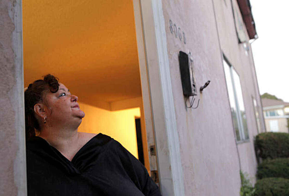 Trina Sanchez looks out the door of her apartment where she moved two months ago, Thursday Nov. 11, 2010, in Vallejo, Calif. She is not able to her outside because her apartment is not handicap accessible.