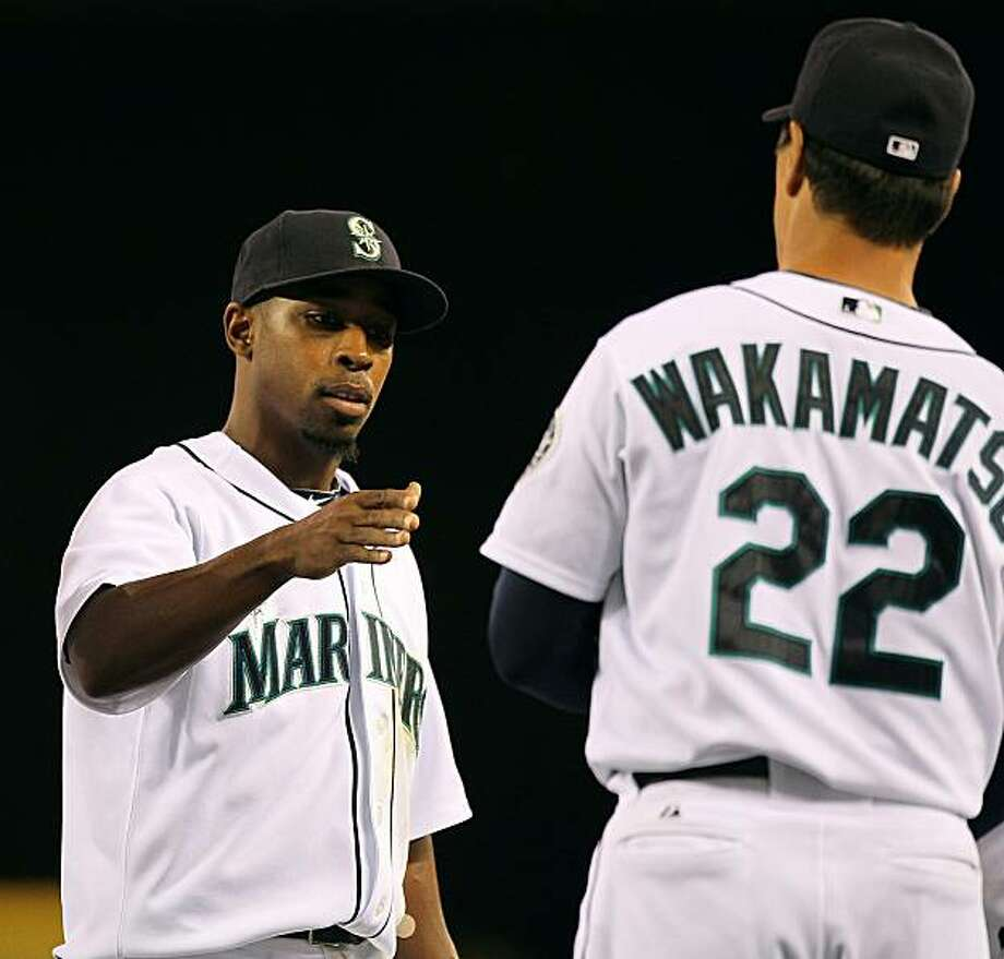 SEATTLE - JULY 24:  Chone Figgins #9 of the Seattle Mariners is congratulated by manager Don Wakamatsu #22 after defeating the Boston Red Sox 5-1 at Safeco Field on July 24, 2010 in Seattle, Washington. Photo: Otto Greule Jr, Getty Images