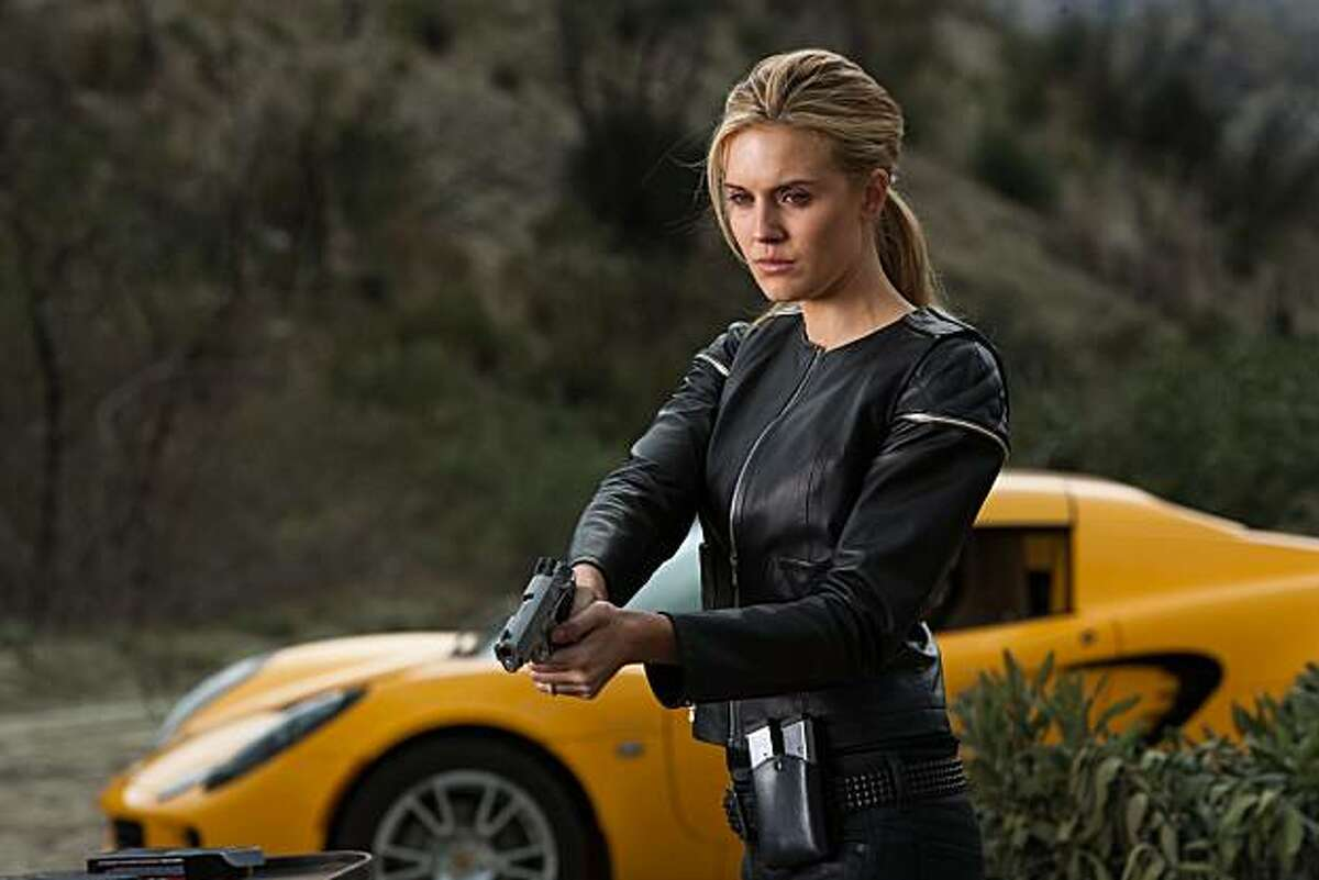 Lily (Maggie Grace) fires her gun furiously after Killer's death