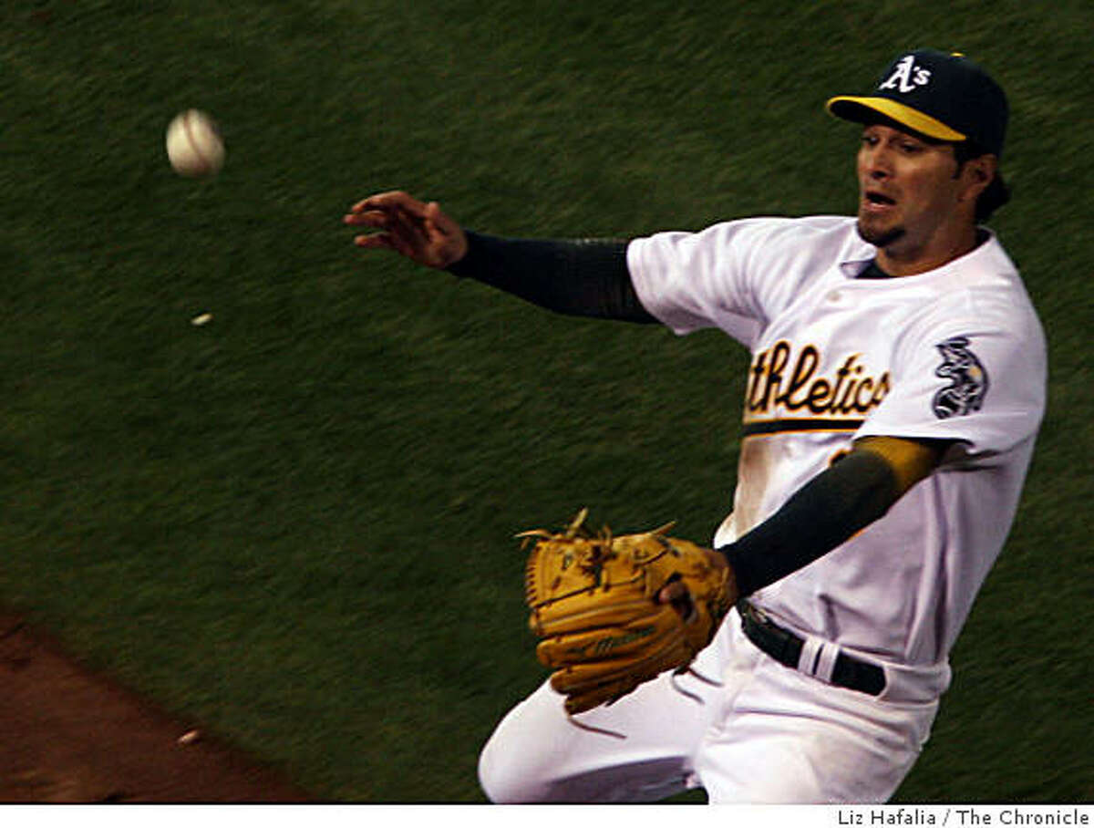 Eric Chavez doesn't quite reach a foul ball during the seventh inning on Friday night.
