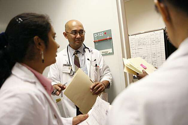 Edrick Pejoro, a physician assistant student, discusses the day's number of patients at the free clinic with other Stanford Medical School students at Menlo Park VA in Menlo Park, Calif. on Sunday, Oct. 10, 2010. A free clinic run by students from the Stanford Medical School services homeless, uninsured and immigrant individuals and families, and will celebrate its 20th anniversary this year. Photo: Kirsten Aguilar, The Chronicle
