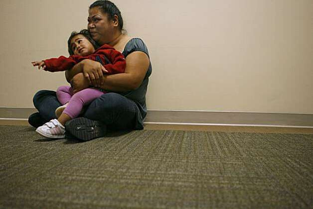 Koa Finau holds her daughter Princess Finau in a hallway nearby the waiting room while she and her family wait to be given PPD shots at Menlo Park VA in Menlo Park, Calif. on Sunday, Oct. 10, 2010. A free clinic run by students from the Stanford Medical School services homeless, uninsured and immigrant individuals and families, and will celebrate its 20th anniversary this year. Photo: Kirsten Aguilar, The Chronicle