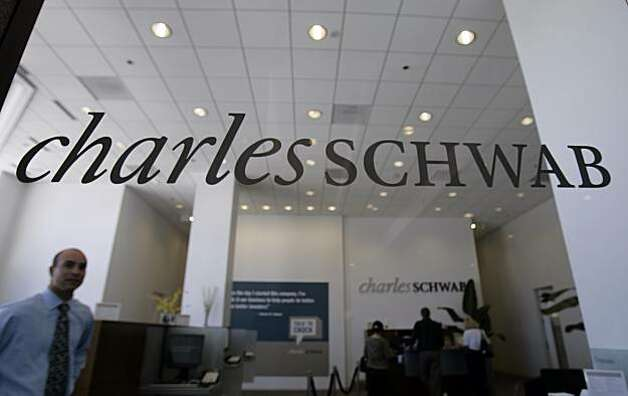 Charles Schwab Corp. said Wednesday that its first-quarter earnings dropped 29 percent     **FILE** An interior view of Charles Schwab offices is shown in San Mateo, Calif., in this July 2, 2007 file photo. Charles Schwab Corp. on Wednesday, Jan. 16, 2008 said its fourth-quarter earnings fell 34 percent due to the sale of its wealth management unit, U.S. Trust. (AP Photo/Paul Sakuma, file) Photo: Paul Sakuma, AP