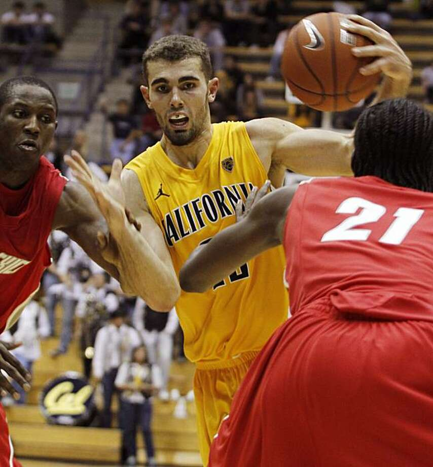 California's Harper Kamp, center drives fot the basket through New Mexico's Emmanuel Negedu, left, of Nigeria, and Tony Snell during the second half of an NCAA college basketball game, Saturday, Nov. 20, 2010 in Berkeley, Calif. California Beat New Mexico89-64. Photo: George Nikitin, AP