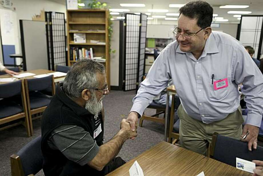 Scott Spetter, 47, welcomes Mohammed Jaka, of San Jose, to the   ProMatch registration where Spetter volunteers six hours a week helping other unemployed workers get signed up for services offered by the program on Wednesday, November 24, 2010 in Sunnyvale, Calif.  Spetter, a husband and father of five children, continues searching for a job after being laid off by Cisco Systems 16 months ago. Photo: John Sebastian Russo, Special To The Chronicle