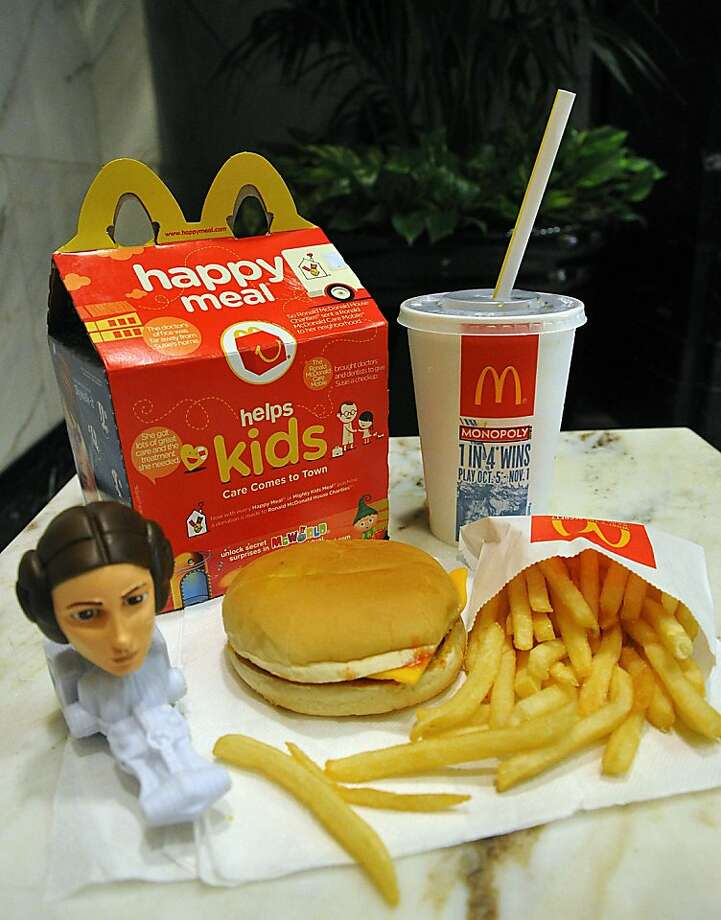 "(FILES)This October 13, 2010 file photo shows a McDonald's Happy Meal complete with a ""Star Wars"" toy. Fast food giant McDonald's said November 3, 2010 it was ""extremely disappointed"" at a ruling by San Francisco authorities banning high-calorie Happy Meals, which entice children to eat with free toys. The response came after the Californian city's board of supervisors voted to forbid restaurants from giving gifts with meals that contain too much fat and sugar. Photo: Karen Bleier, AFP/Getty Images"