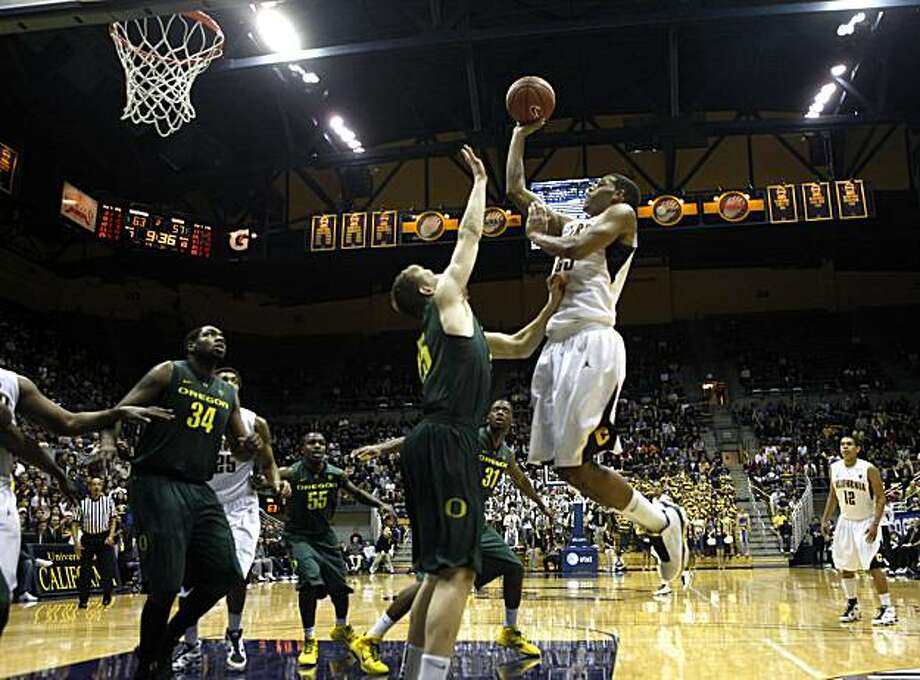 California guard Allen Crabbe (23) goes to the hoop as Oregon's Jeremy  Jacob defends in the second half at Berkeley's Haas Pavilion on Saturday. Photo: Lance Iversen, The Chronicle