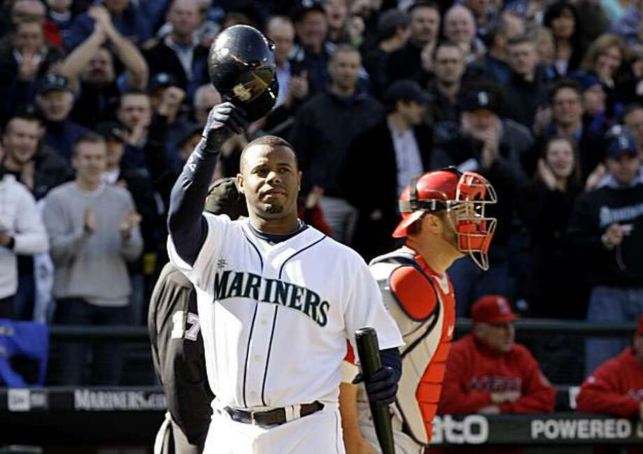 Seattle Mariners' Ken Griffey Jr. tips his helmet while fans give him a standing ovation as he steps to the plate against the Los Angeles Angels in the first inning Tuesday, April 14, 2009, during a baseball game in Seattle. (AP Photo/Elaine Thompson) Photo: Elaine Thompson, AP