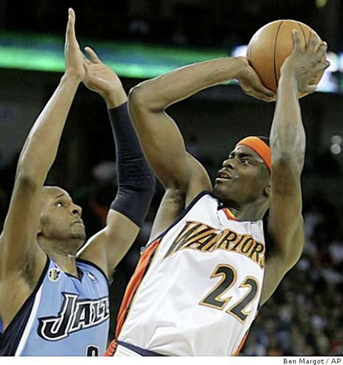 Utah Jazz' C.J. Miles, left, guards Golden State Warriors' Anthony Morrow during the first half of an NBA basketball game Sunday, March 1, 2009, in Oakland, Calif. (AP Photo/Ben Margot)