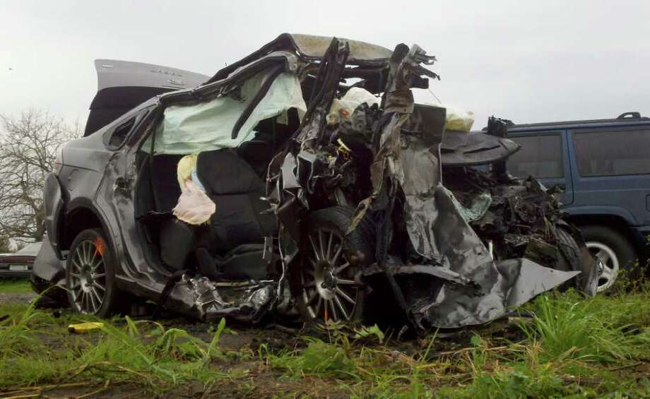 A car in which four people died when it was involved in a 5-fatality wreck on Interstate 10 near LaPlace, La. is seen Friday, Feb. 10, 2012 in LaPlace, La. Louisiana State Trooper Nick Manale says a driver was traveling eastbound in the westbound lanes of I-10 near LaPlace early Friday and crashed head-on with another vehicle with four inside. The car traveling the wrong way burst into flames. All five people died at the scene.  (AP Photo/The Times-Picayune, Brett Duke)  MAGS OUT; NO SALES; USA TODAY OUT Photo: Brett Duke, MBR / The Times-Picayune