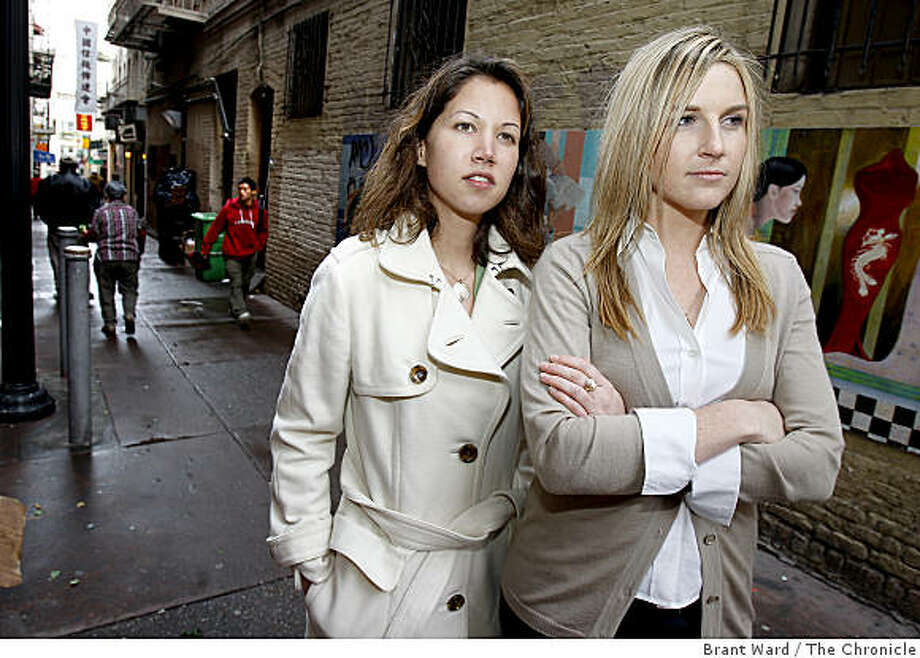 Casey Wilson (left) and Courtney McColgan in San Francisco's Chinatown stop to look down Ross Alley Thursday April 9, 2009. Casey Wilson and Courtney McColgan have started a website called Wokai.org, a microlending portal for rural Chinese which is getting thousands of responses. Photo: Brant Ward, The Chronicle