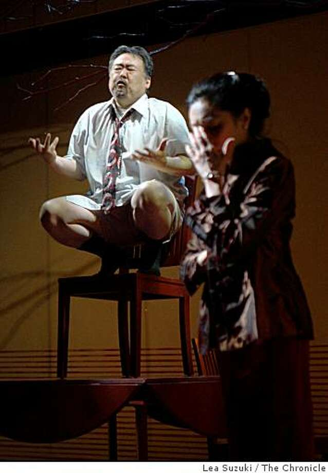 """Keone Young (l to r) performs as Min Suk Chun and Jodi Long performs as Mary Chun during a dress rehearsal of  """"American Hwangap,"""" at the Magic Theater at Fort Mason in San Francisco, Calif. on Wednesday April 8, 2009. Photo: Lea Suzuki, The Chronicle"""