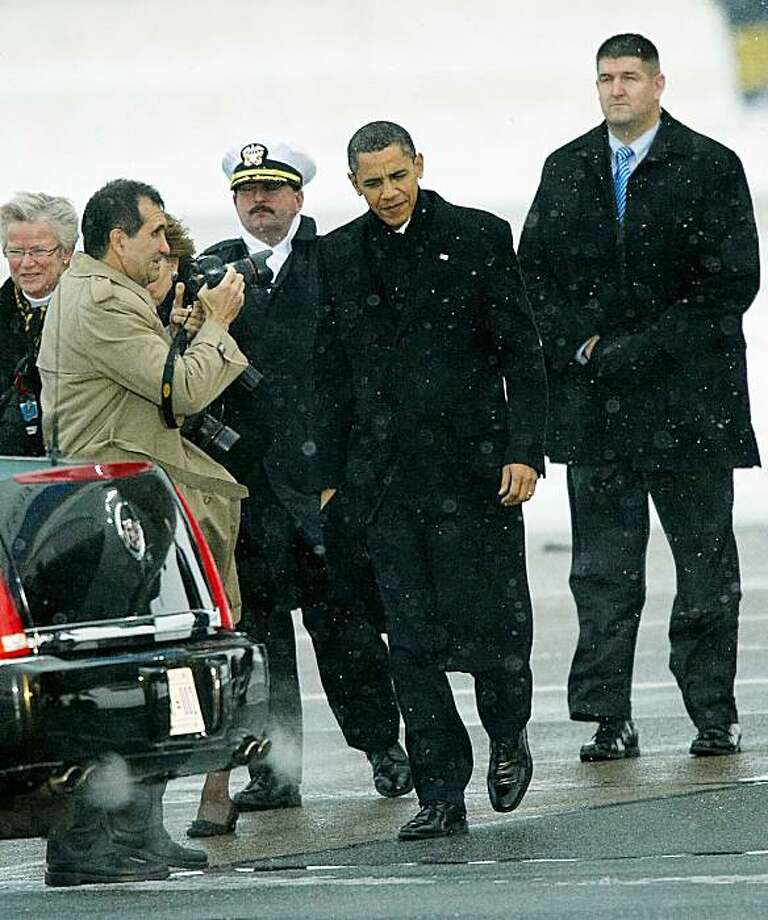 In this Dec. 18, 2009 file photo,  U.S. President Barack Obama arrives at Copenhagen Airport for the climate conference in Copenhagen. The disappointment of Copenhagen _ the failure of the annual U.N. conference to produce a climate agreement last year in the Danish capital _ has raised doubts about whether the long-running, 194-nation talks can ever agree on a legally binding treaty for reining in global warming. Cancun, Mexico will host the 2010 climate conference. (AP Photo/POLFOTO, Jens Dige, File) DENMARK OUT Photo: Jens Dige, AP