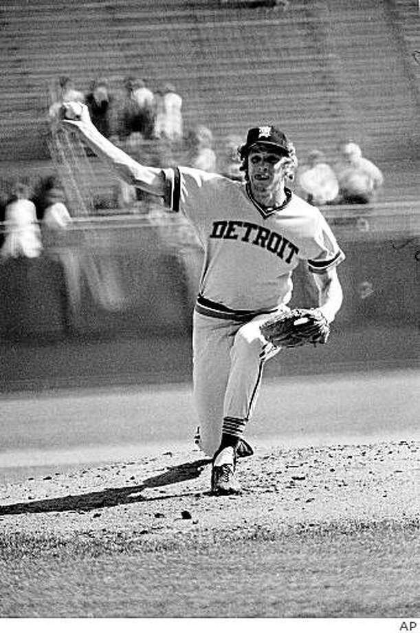 "** TAKES OUT PLAYOFF GAME ** ** FILE ** In this Oct. 3, 1976 file photo, Detroit Tigers' pitcher Mark Fidrych delivers a pitch during a baseball game with the Brewers, in Milwaukee, Wis.   Fidrych has been found dead in an apparent accident at his farm in Northborough, Mass. on Monday, April 13, 2009.  He was 54.  Mark ""The Bird"" Fidrych  was the American League rookie of the year in 1976 when he went 19-9 with a 2.34 earned run average. He spent all five of his major league seasons with the Detroit Tigers, compiling a 29-19 record and a 3.10 ERA. (AP Photo) Photo: AP"