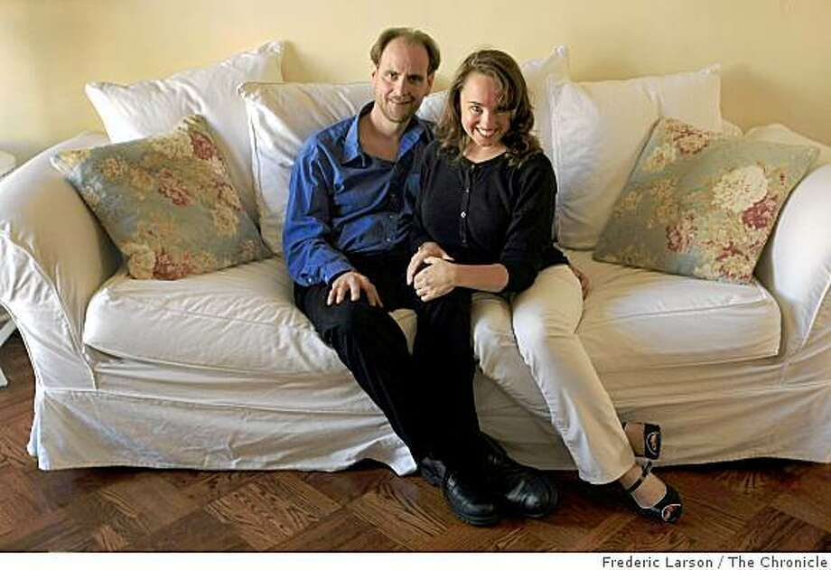 "Colleen Holland (right) and Joe Connelly, pose for a ""An On the Couch"" portrait for Style at their home in San Francisco on April 3, 2009. Photo: Frederic Larson, The Chronicle"