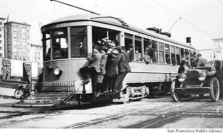 """Here is a photo of Muni car No. 1 on its very first trip, with Mayor James Rolph, Jr. at the controls, on the """"A-Geary"""" line, bound for Tenth Avenue and Fulton Streets.  The car is headed westbound on Geary at Jones Street, December 28, 1912, Muni's opening day.timeline_144 Photo: San Francisco Public Library"""