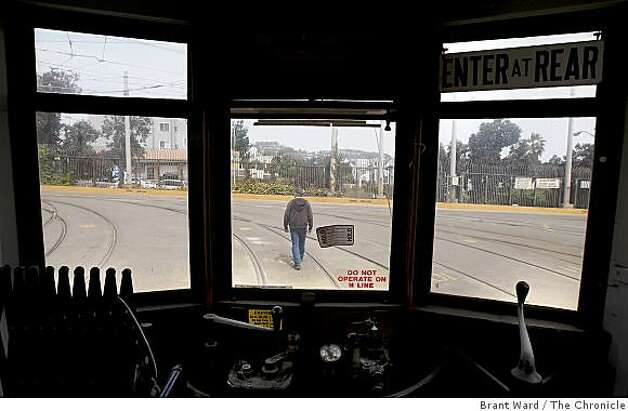 A view out the window in the MUNI yard. The streetcar will soon be moved for renovation. San Francisco's first publicly owned streetcar, which made its maiden run 97 years ago, will be restored at a cost of $1.8 million in time for MUNI's centennial celebration. Photo: Brant Ward, The Chronicle