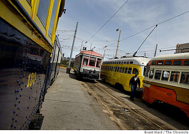 The old No. 1 streetcar (rear center) is stored with other historic streetcars at the Geneva Avenue yard. San Francisco's first publicly owned streetcar, which made its maiden run 97 years ago, will be restored at a cost of $1.8 million in time for MUNI's centennial celebration. Photo: Brant Ward, The Chronicle