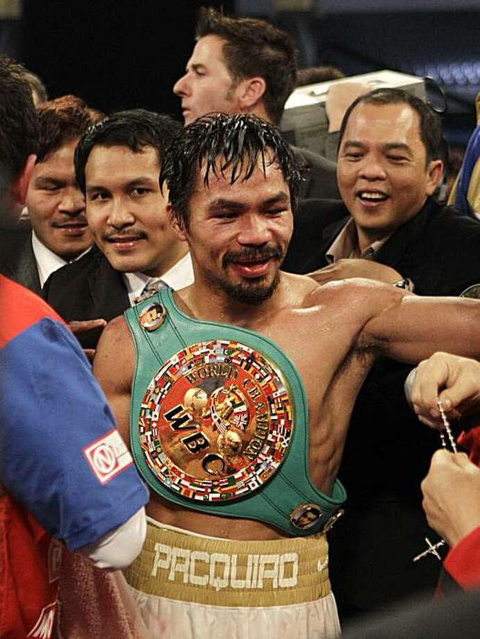 Manny Pacquiao wears the championship belt after winning the WBC light middleweight title boxing match against Antonio Margarito Saturday, Nov. 13, 2010, in Arlington, Texas. Photo: David J. Phillip, AP