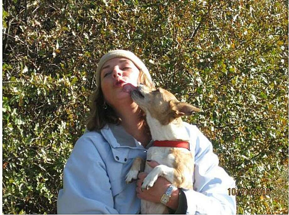 Volunteer dog-walker Fiona Johannessen with one of the dogs from the Nevada County Animal Shelter. Photo: Mike Galligan